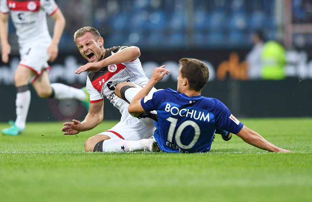 Bernd Nehrig could have opened the scoring early on. Here is fouled by Bochum's Thomas Eisfeld.