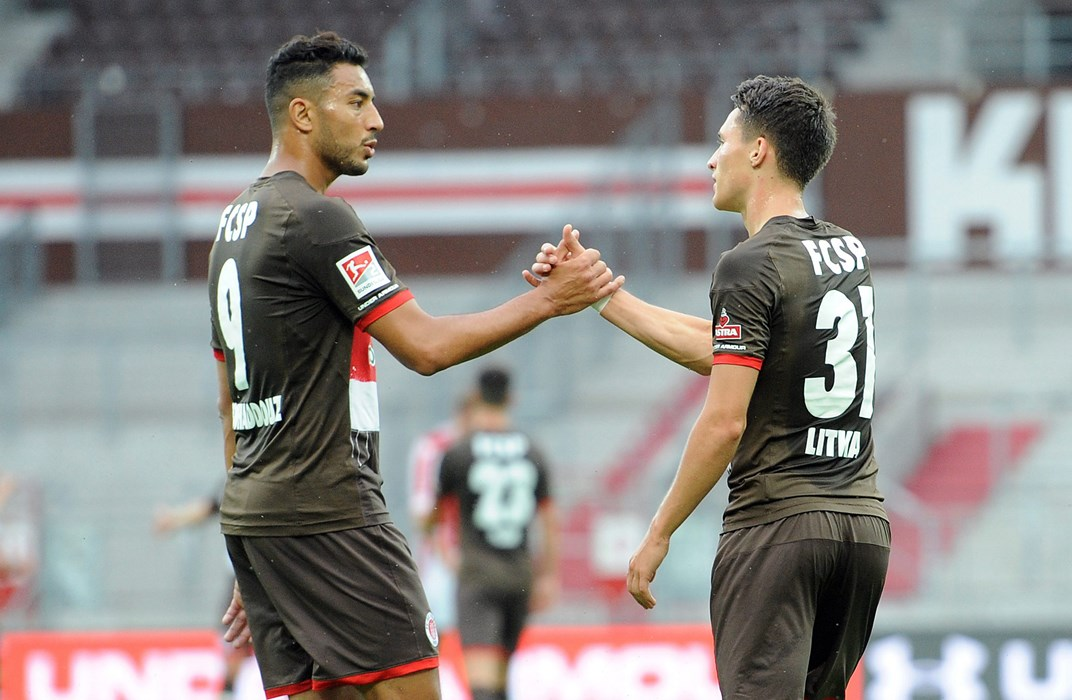 Aziz Bouhaddouz (left) congratulates Maurice Litka on his goal to make it 2-0.