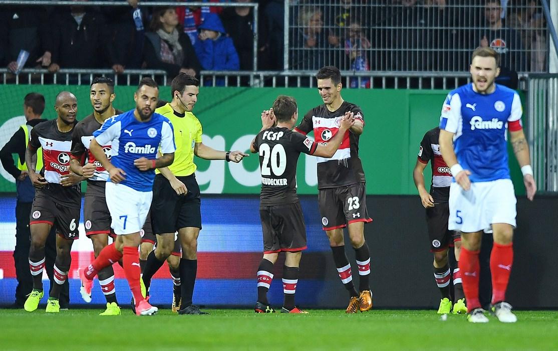 Goalscorer Johannes Flum celebrates with Richie Neudecker, who provided the assist.