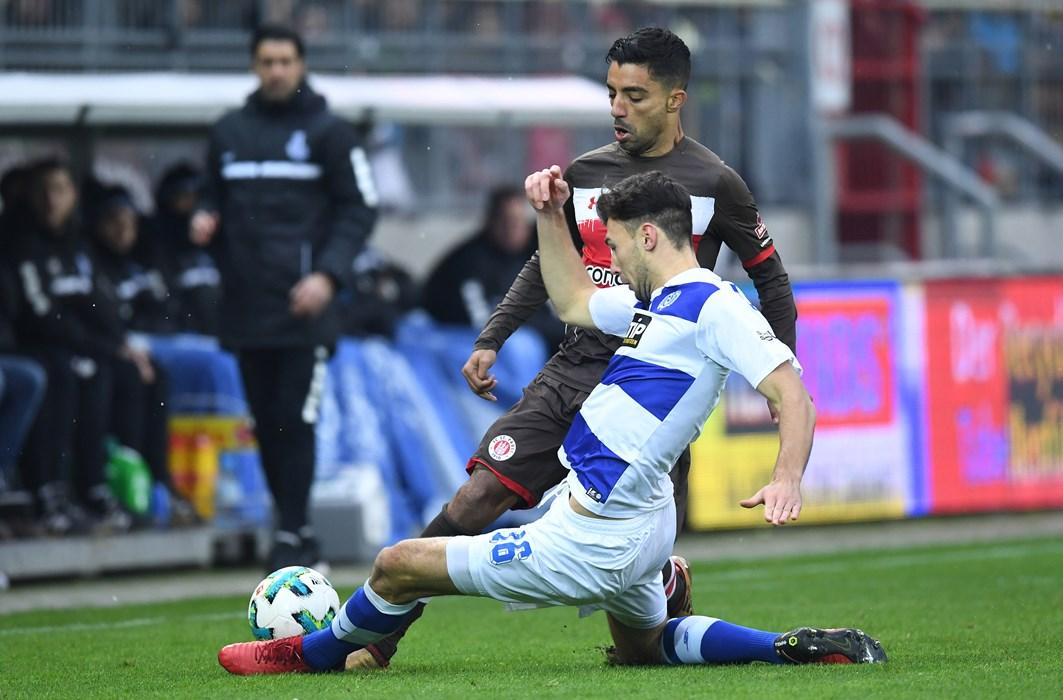 Lukas Fröde slides in to stop Sami Allagui.