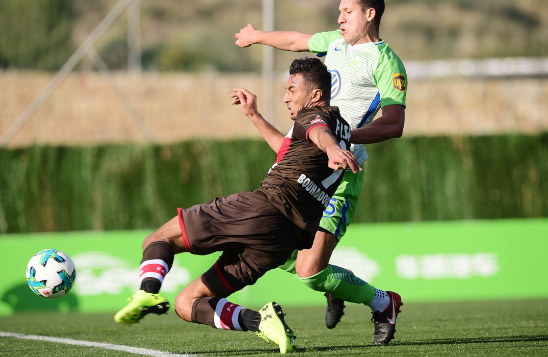 Aziz Bouhaddouz pulls the trigger on the stroke of half time - Jeffrey Bruma arrives too late but Koen Casteels (out of shot) was on hand to make the save.