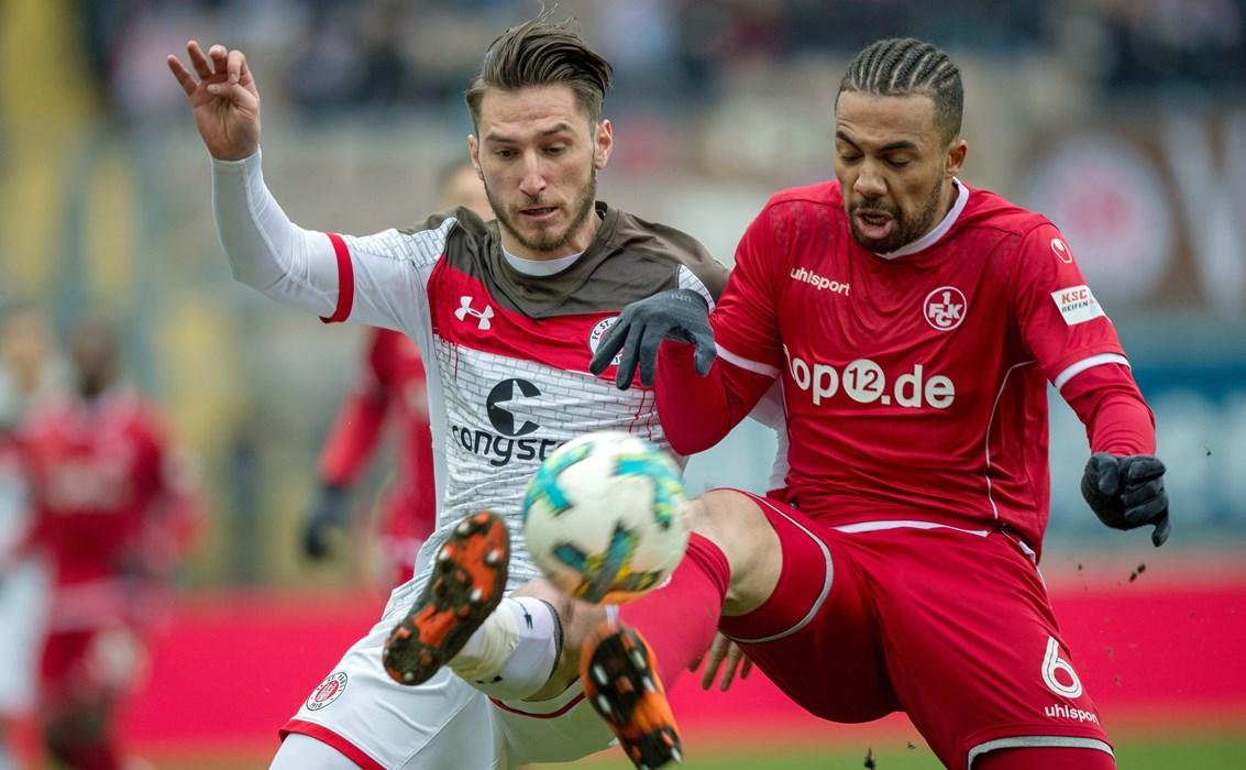 Dimitrios Diamantakos in a challenge with Leon Guwara.