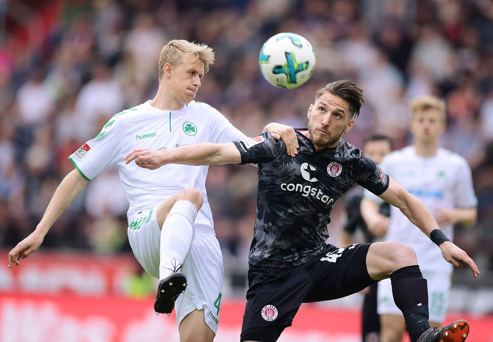 Dimitrios Diamantakos, who scored his first competitive goal for the club today, challenges for the ball with Fürth's Lukas Gugganig.