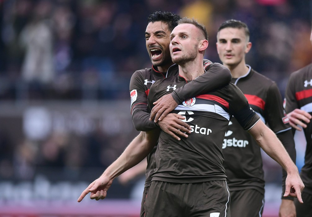 Sami Allagui hugs goalscorer Bernd Nehrig in the 16th minute.