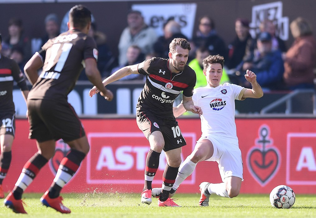 Goalscorer Christopher Buchtmann under challenge from Clemens Fandrich.