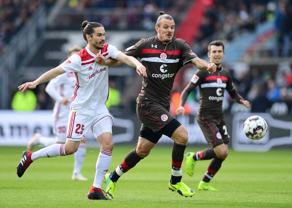 Goalscorer Alex Meier under challenge from Ingolstadt's Jonatan Kotzke