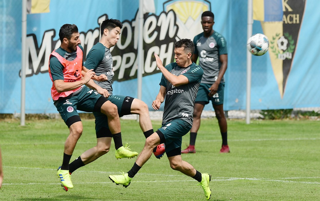 Flat out at the Austrian training camp - Cenk Sahin challenges for the ball with Yiyoung Park and Waldemar Sobota.