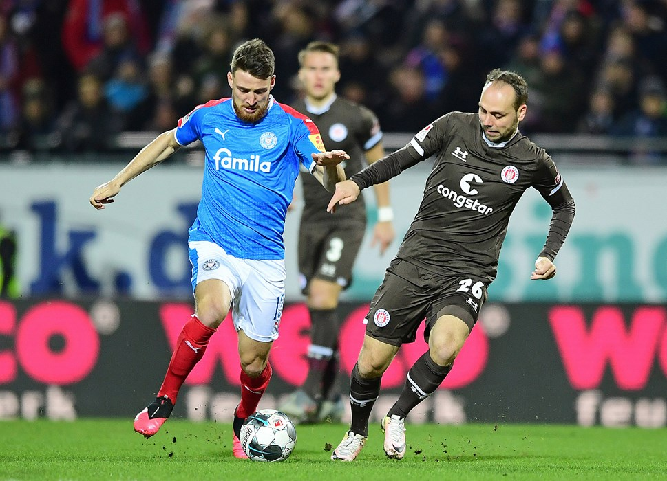 Rico Benatelli challenges Kiel goalscorer Salih Özcan.