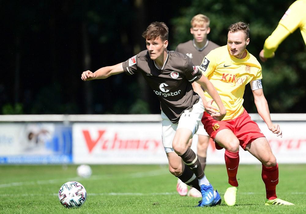 Midfielder Christian Viet escapes the attentions of Meppen captain Florian Egerer.